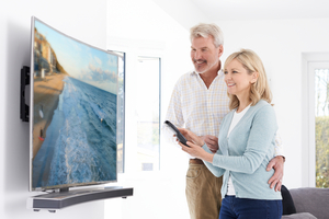 Couple with new television